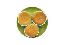 Пирожные на зеленой плите Стоковые Изображения