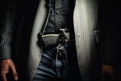Пистолет человека и серебра Стоковые Изображения