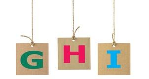 Письма алфавита на изолированном ярлыке картона Комплект 7 Стоковая Фотография RF