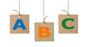 Письма алфавита на изолированном ярлыке картона Комплект 1 Стоковое фото RF