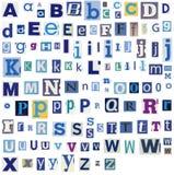 Письма алфавита сделанные из газеты, кассеты Стоковое Изображение