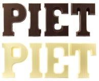Письма в темном и белом шоколаде говоря имя по буквам черного p стоковая фотография rf