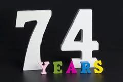 Письма и номера-70-4 на черной предпосылке Стоковое Изображение