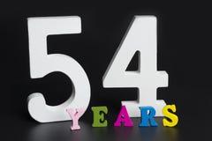 Письма и номера до пятьдесят четыре на черной предпосылке Стоковое фото RF