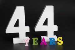 Письма и сорок четыре лет на черной предпосылке Стоковая Фотография RF
