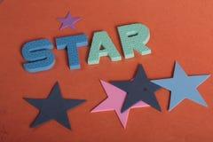 Письма потехи звезды стоковые изображения