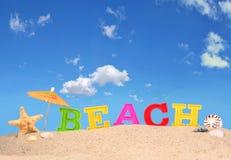 Письма пляжа на песке пляжа Стоковая Фотография RF