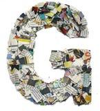 Письма сделанные от capitel g газеты Стоковые Фотографии RF