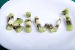 Письма составленные частей плодоовощ кивиа Стоковое фото RF