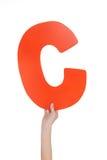 Письмо алфавита в руке ребенка Стоковое Фото
