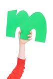 Письмо алфавита в руке ребенка Стоковые Изображения