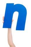 Письмо алфавита в руке ребенка Стоковые Фотографии RF
