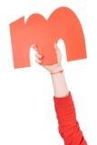 Письмо алфавита в руке ребенка Стоковые Изображения RF