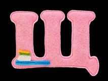 Письмо кириллического алфавита сделанного из изолированного войлока на черноте Стоковое Фото