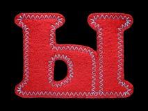 Письмо кириллического алфавита сделанного из изолированного войлока на черноте Стоковые Изображения RF