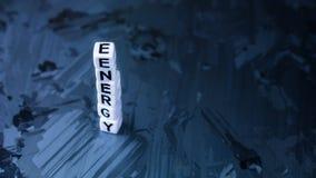 Письмо куба ЭНЕРГИИ в куче на солнечной предпосылке поверхности клетки кремния Концепция экологически чистой энергии Стоковые Фотографии RF