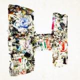 Письмо h газеты сделанное от confetti газеты и кассеты Стоковое Изображение RF