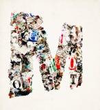 Письмо m газеты сделанное от confetti газеты и кассеты Стоковые Фотографии RF