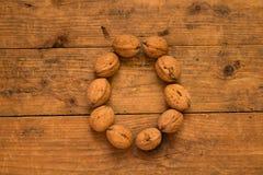 Письмо o сделанное от грецких орехов Стоковое Фото