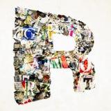 Письмо r газеты сделанное от confetti газеты и кассеты Стоковое Фото
