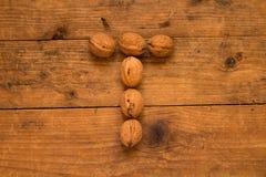 Письмо t сделанное от грецких орехов Стоковое Фото