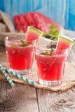 Питье арбуза в стеклах Стоковая Фотография