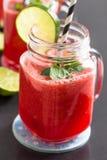 Питье арбуза и известки Стоковые Фото