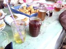 Питье кофе и чая Стоковые Фотографии RF