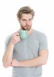 Питье человека от чашки кофе или чая Стоковые Фото