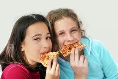 пицца девушок стоковая фотография rf