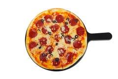 Пицца на белизне белой доски изолированной Стоковые Изображения