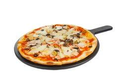 Пицца на белизне белой доски изолированной Стоковое Изображение RF