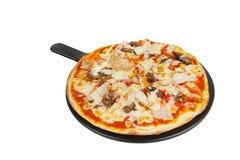 Пицца на белизне белой доски изолированной Стоковая Фотография