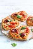Пиццы сердца форменные мини Стоковые Изображения