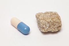 Пилюлька и сахар Стоковое Изображение