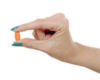 Пилюлька руки и апельсина женщины Стоковая Фотография RF