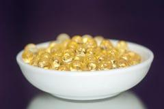 Пилюльки витамина (a, d, e, рыбий жир) Стоковая Фотография RF