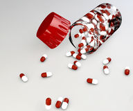 Пилюльки и бутылка аспирина Стоковое Изображение