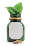 Пилюльки капсул био и бутылка Стоковые Фото