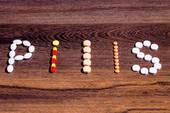 ` Пилюльки ` слова построенное с таблетками стоковое фото rf