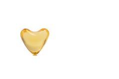 Пилюльки цвета сердца рыбьего жира Стоковые Фото