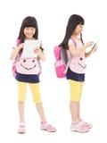 ПК касающей таблетки студента маленькой девочки Стоковое Изображение RF