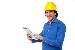 ПК таблетки рабочий-строителя работая Стоковая Фотография RF