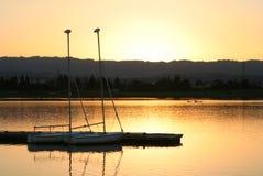 плавает заход солнца Стоковая Фотография RF