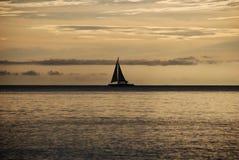 Плавать на заходе солнца Стоковые Фото