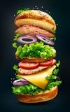 Плавая изолированный бургер стоковое изображение rf