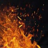 Пламенистая предпосылка энергии с искрами стоковые фото