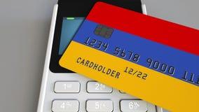 Пластиковая карта банка отличая флагом Армении и терминала оплаты POS Армянская банковская система или розничное родственное 3D видеоматериал