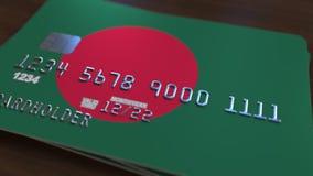 Пластиковая карта банка отличая флагом Бангладеша Анимация бангладешской национальной банковской системы родственная бесплатная иллюстрация