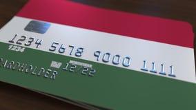 Пластиковая карта банка отличая флагом Венгрии Анимация венгерской национальной банковской системы родственная иллюстрация штока